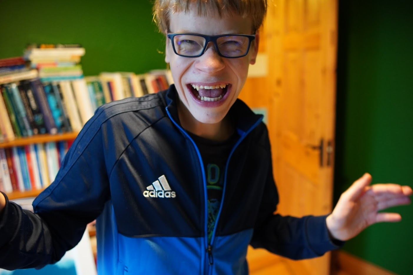 Laughing boy wearing glasses