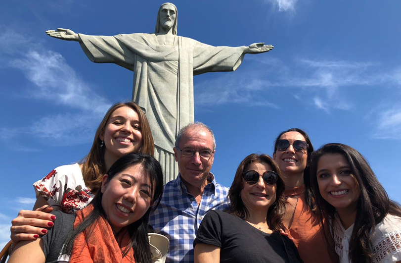 six people in front of christ the redeemer